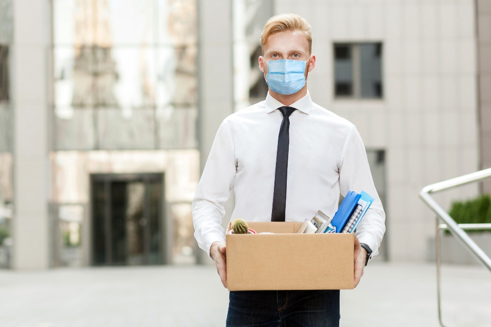 Masked Man Walking Out of an Office
